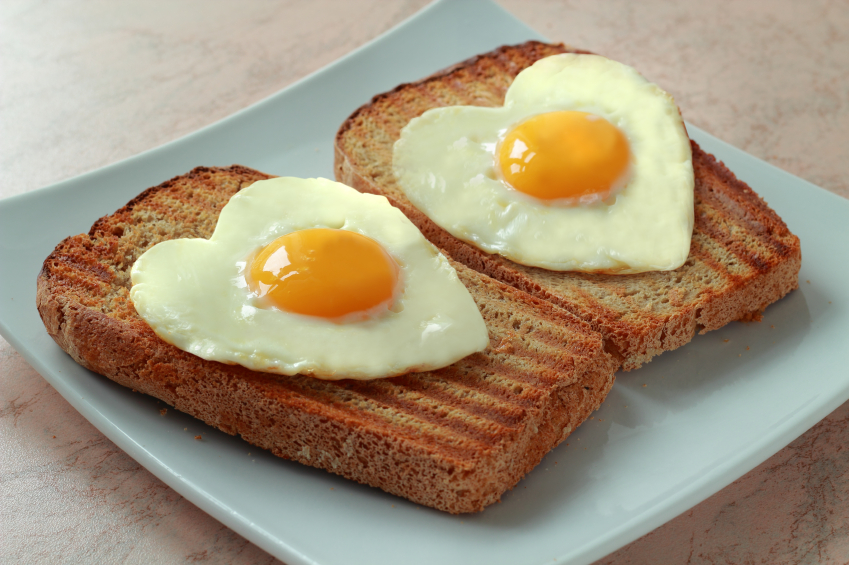 Fried eggs as a heart on a toast