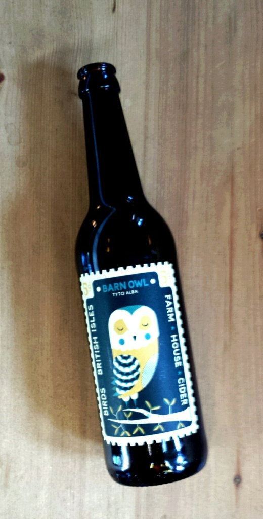 BEER - WITH AN OWL ON IT